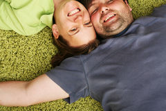 Happy couple laying together stock images