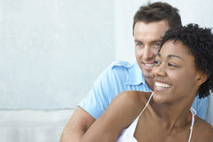 Happy Couple Leaning Together Against Wall Stock Image