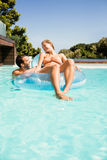 Happy couple with lilo in the pool Royalty Free Stock Photo