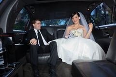 Happy couple in limousine Stock Photo