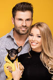 Happy couple with little dog. Royalty Free Stock Image