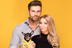 Happy couple with little dog. Royalty Free Stock Photography