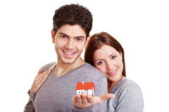 Happy couple with little house Stock Images