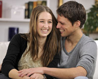 Happy couple in living room Royalty Free Stock Image