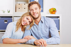 Happy couple in living room Royalty Free Stock Photography