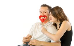 Happy Couple With Lollipop. Happy couple with big red lollipop holding by girl stock images