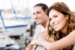 Happy couple looking away, harbour view Royalty Free Stock Images
