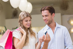 A happy couple looking at beauty product Stock Images
