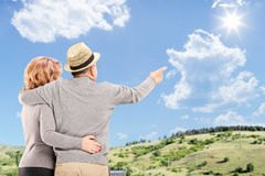 Happy couple looking at the blue sky, outdoors Stock Image