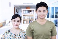 Happy couple looking at camera at home Royalty Free Stock Image
