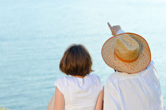 Happy couple looking on copyspace over blue sea Stock Photography