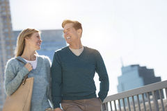 Happy Couple Looking At Each Other In City Stock Image