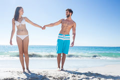 Happy couple looking at each other while holding hands Royalty Free Stock Photos