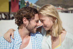 Happy couple looking face to face at beach Stock Photo