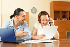 Happy couple looking financial document Stock Image