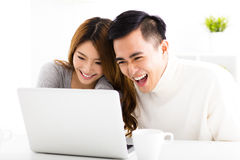 Happy  Couple Looking at Laptop In living room Royalty Free Stock Image