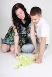 Happy couple looking on little baby Stock Photo