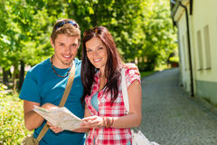 Happy couple looking on map in park Royalty Free Stock Images