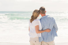 Happy couple looking out to sea Royalty Free Stock Photography