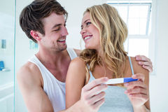 Happy couple looking at pregnancy test Royalty Free Stock Photo