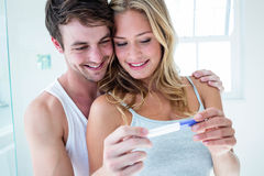 Happy couple looking at pregnancy test Royalty Free Stock Photos
