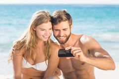 Happy couple looking at smartphone Royalty Free Stock Image
