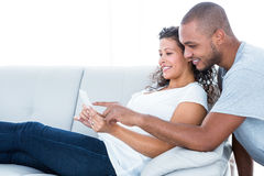 Happy couple looking at sonography Stock Photography