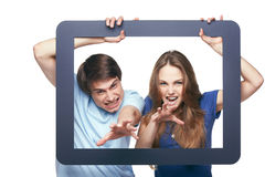 Happy couple looking through tablet frame Stock Image
