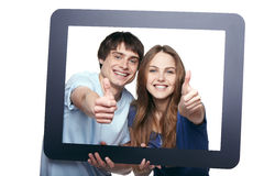 Happy couple looking through tablet frame Stock Photography