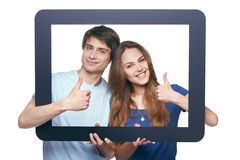 Happy couple looking through tablet frame Royalty Free Stock Images