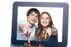 Happy couple looking through tablet frame Royalty Free Stock Photography