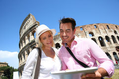 Happy couple looking at tablet in Rome on sunny day Royalty Free Stock Images