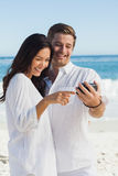 Happy couple looking at their camera Stock Photography
