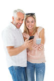 Happy couple looking at their smartphones Stock Image