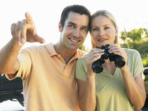 Happy Couple Looking At View Stock Photography