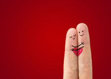 А happy couple in love. With painted smiley and hugging Stock Photography