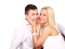Happy couple in love. Smiling over white background Stock Images