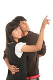 Happy couple in love. Young happy couple in love pointing to bright future Stock Images
