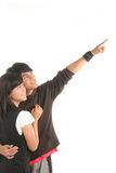 Happy couple in love. Young happy couple in love pointing to bright future Stock Photos
