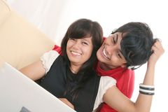 Happy couple in love. Young happy couple in love hugging on sofa with laptop Stock Photography