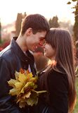 Happy couple in love in autumn outdoors Stock Photo
