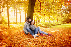 Happy couple in love  in autumn park Stock Photos
