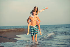 Happy couple in love on beach summer vacations. Royalty Free Stock Image