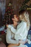 Couple celebrating Christmas at home stock image