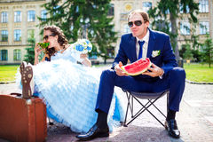Happy couple in love at city park eating Royalty Free Stock Photography
