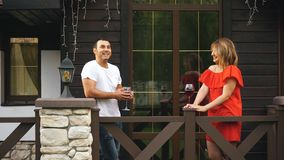Happy couple in love drinking wine and taking on the veranda stock video