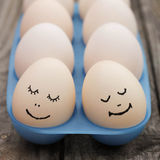 Happy couple in love. Eggs Royalty Free Stock Photos