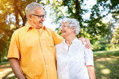 Happy couple in love. An embrace at the park Stock Images
