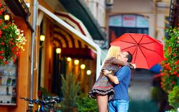 Happy couple in love embracing on colorful street Stock Photo