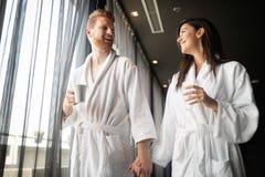 Happy couple in love enjoying wellness weekend stock image
